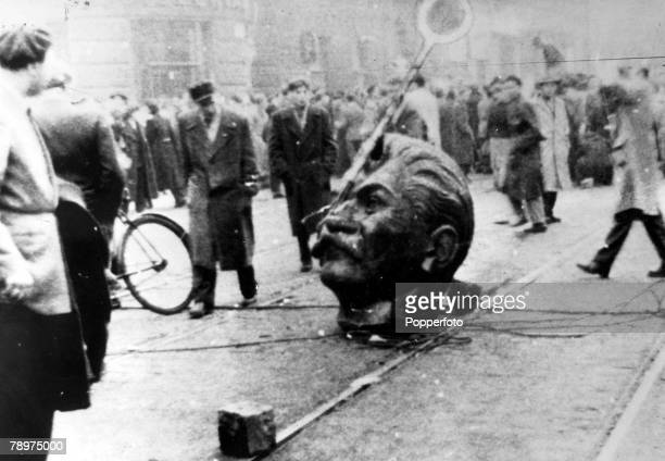 1956 Budapest Hungary 1956 Hungarian Uprising Communism took on new forms and Stalins statue was toppled from his pedestal as protestors expressed...