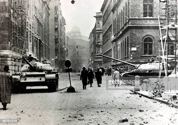 Budapest Hungary 29th October 1956 Russian tanks stand guard at an intersection in the city of Budapest to stop mass demonstartions and rioting after...