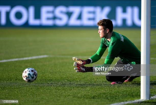 Budapest , Hungary - 8 June 2021; Republic of Ireland goalkeeper Mark Travers warms up before the international friendly match between Hungary and...