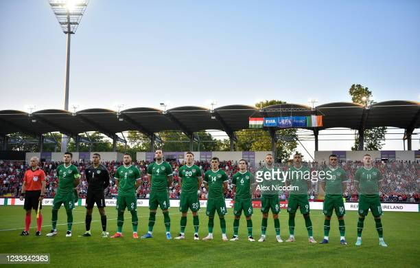 Budapest , Hungary - 8 June 2021; Republic of Ireland players stand for the playing of the National Anthem before the international friendly match...