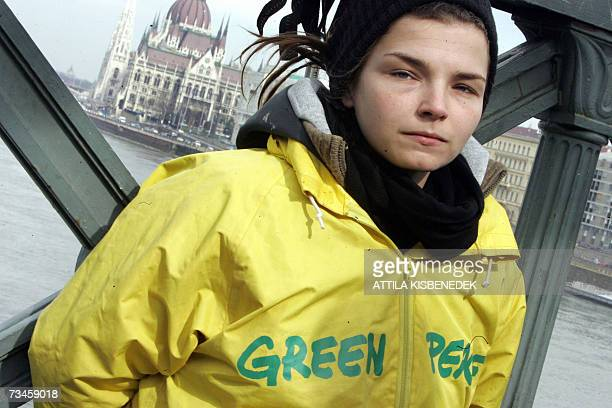 Greenpeace activist is chained to the oldest Hungarian bridge, the Chain Bridge of Budapest as Hungarian and foreign activists of Greenpeace hang on...