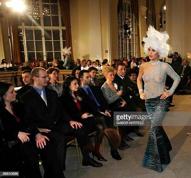Model presents a dress of Hungarian designer Tamas Naray in the Gala Hall of the Agriculture Museum of Budapest 21 January 2005 during a fashion show...