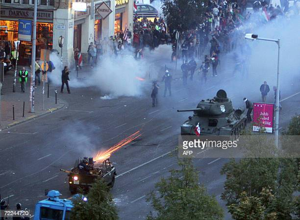 A WWII Soviet T34 tank seized by protesters during clashes stops before riot police firing to disperse demonstrators 23 October 2006 in central...