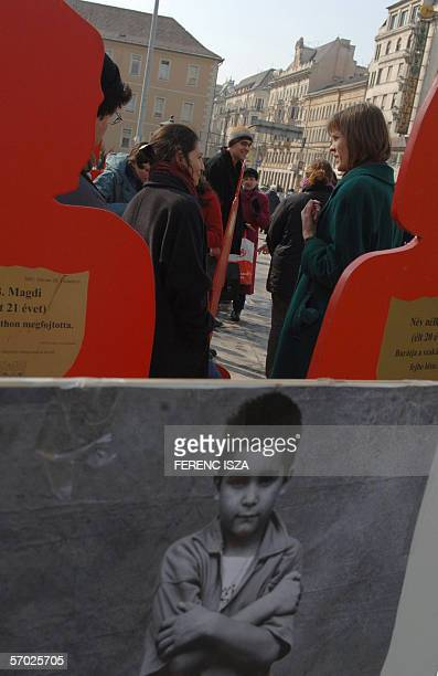 """Activists stand in front of red cut-outs of women 08 March 2006 as associations, Amnesty International, """"NANE"""", women's rights assoation, """"Habeas..."""