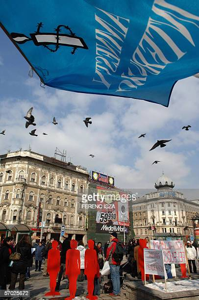 """An Amnesty International flag floats in the air 08 March 2006 as associations, """"NANE"""", women's rights assoation, """"Habeas Corpus"""" Working Groups,..."""