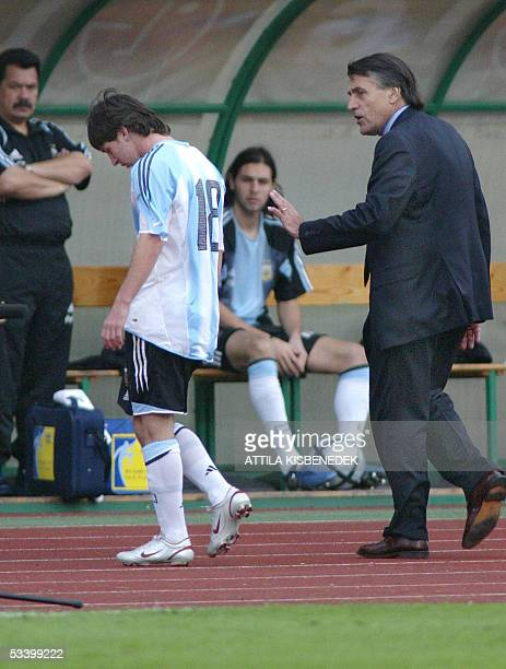Argentine's Lionel Messi is comforted by his coach Jose Pekerman after receiving a red card at the Puskas stadium in Budapest, 17 August 2005 during...