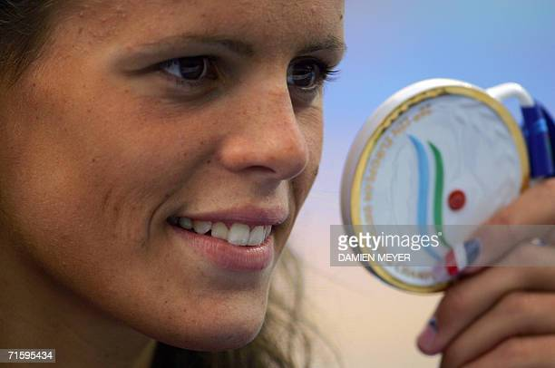 Gold medalist and new recordwoman Laure Mamaudou of France shows her medal after her women's 400m freestyle final during the 28th LEN European...