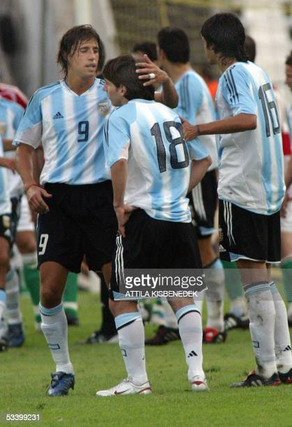 In his first match in the national team Argentine Lionel Messi is comforted by his teammates Hernan Crespo and Luis Gonzales as he received a red...