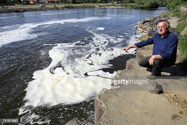 Photo taken 08 April 2007 as an activist of 'Charity for Raba River', Hungarian Attila Doczi shows a thin layer of polluted spume on the surface of...