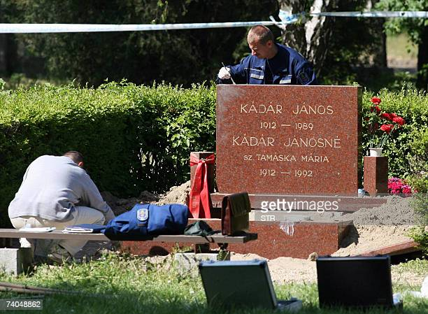 Police inspectors examine the graves of former Hungarian communist leader Janos Kadar and his wife Maria Tamaska, 02 May 2007, after assailants...