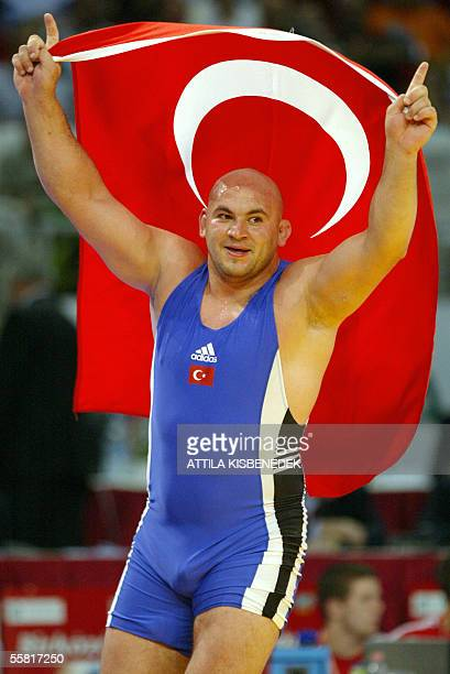 Turkish Aydan Polatci celebrates his gold medal with his national flag after beating Alexis Rodriguez of Cuba in 'Laszlo Papp' Sport Arena of...
