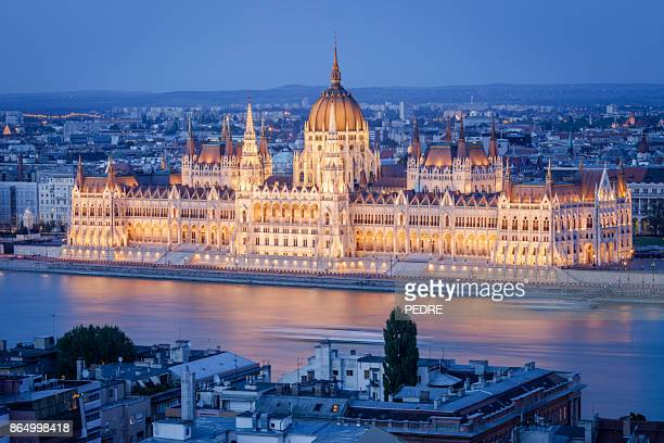 budapest parliament at night - budapest stock pictures, royalty-free photos & images