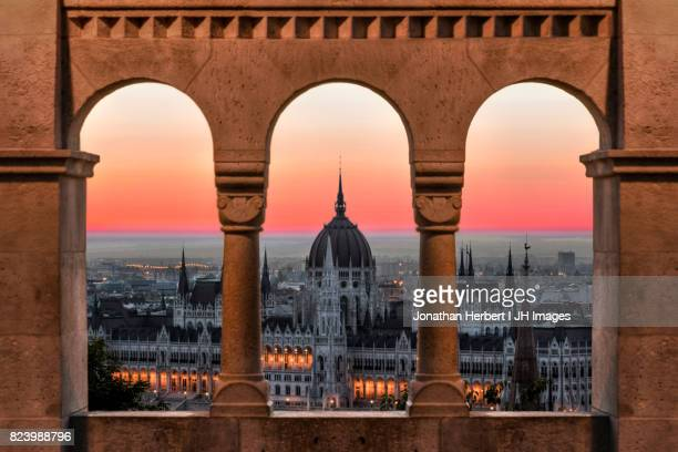 budapest parliment from the window - budapest stock pictures, royalty-free photos & images