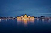 reflection illuminated hungarian parliament building danube