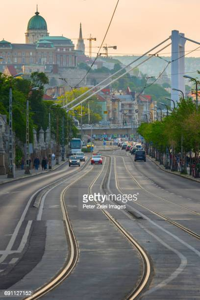 Budapest street scene with the Elizabeth Bridge and the Buda Castle in the background