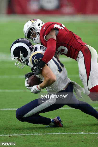 Budda Baker of the Arizona Cardinals tackles Cooper Kupp during the game against the Los Angeles Rams at University of Phoenix Stadium on December 3...