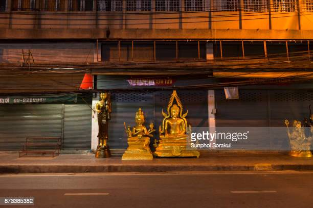 Buddha and Brahma statues on the street of Bangkok, Thailand