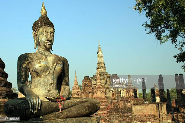 Buddha and Buddhist Temple in Sukhothai at Sunrise