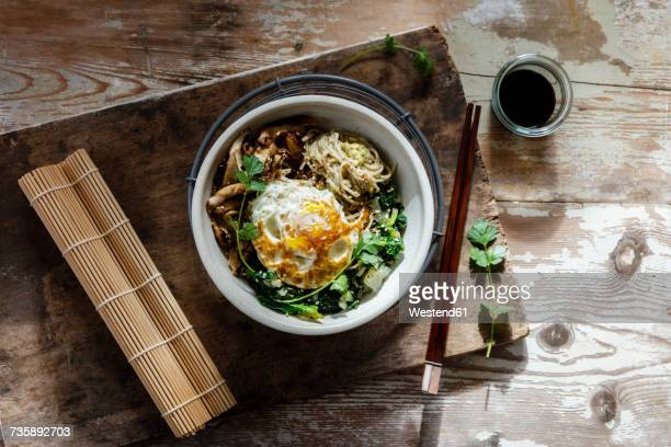 Buddha Bowl of spinach, mushrooms, noodels and fried egg