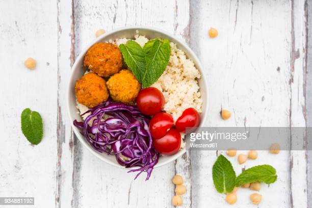 Buddha bowl of sweet potato balls, Couscous, Hummus and vegetables