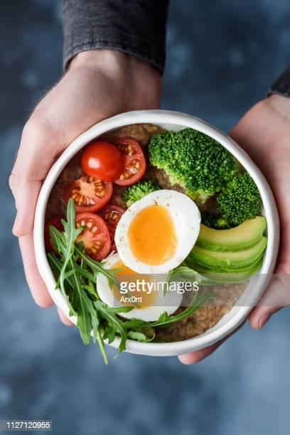 buddha bowl with broccoli egg tomato avocado - schaal serviesgoed stockfoto's en -beelden