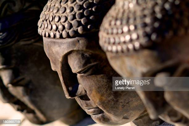 buddha faces at sunday market. - day of the week stock pictures, royalty-free photos & images