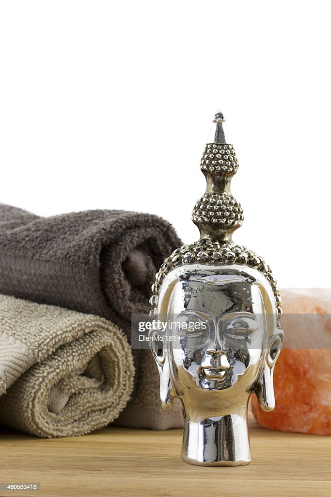 buddha figure with towels on the background : Stock Photo