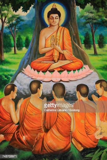 Buddha gave his first sermon to five disciples in Benares. Ceiling Artwork depicting the story of Shakyamuni Buddha. Wat Ong Teu Mahawihan. Temple of the Heavy Bouddha. Ventiane. Laos.  Laos.