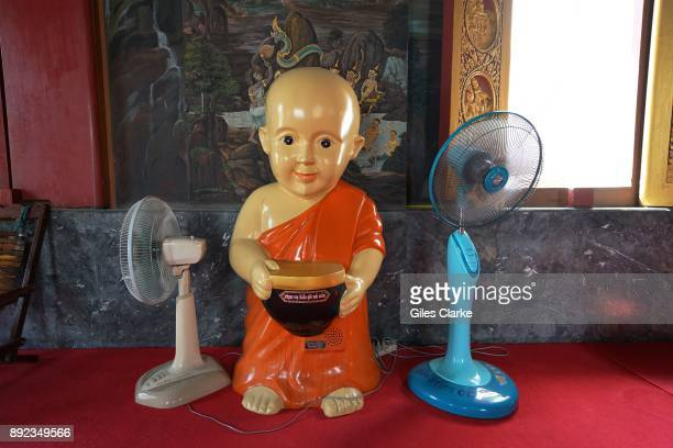 A Buddha Icon inside a stilted house on the Chao Phraya river Situated on the banks of the Chao Phraya river a few miles inland from the Gulf of...