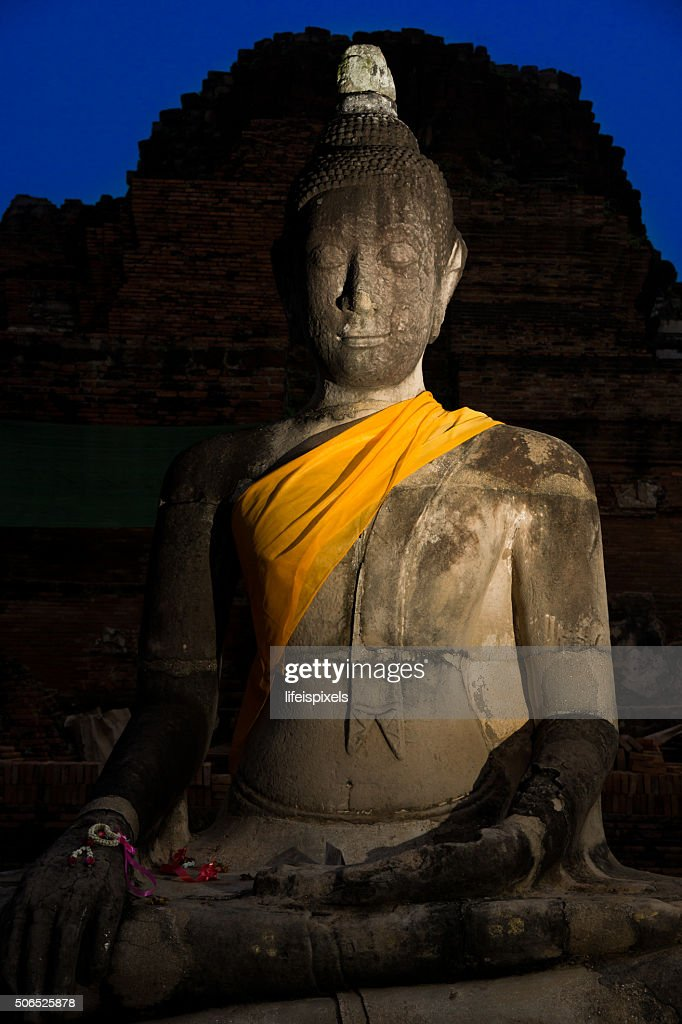 Buddha Image sitting silently in the dark : Stock Photo