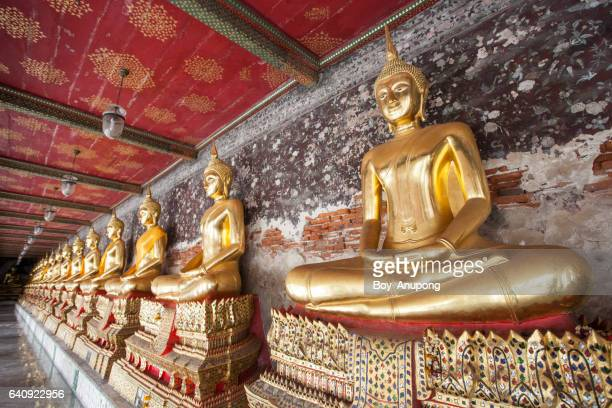 buddha images in the cloister in wat pho, bangkok of thailand. - wat pho stock pictures, royalty-free photos & images