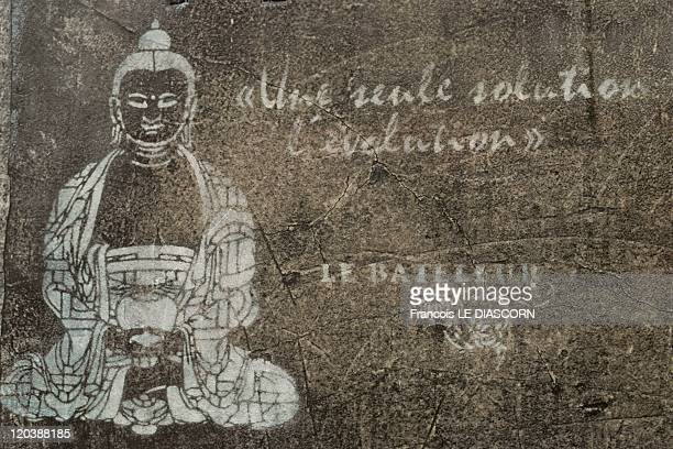 Buddha in Paris France Buddha with a quotation on a wall