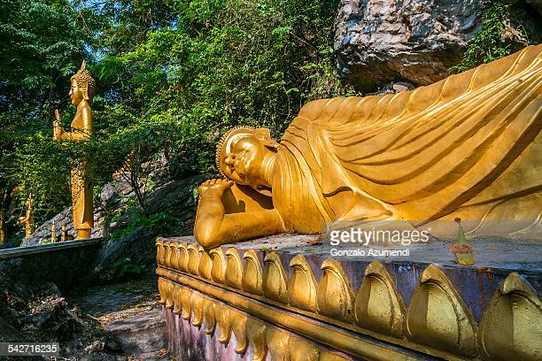 buddha in phu si hill in luang prabang - laotian culture stock pictures, royalty-free photos & images