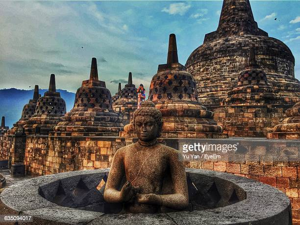 buddha sculpture and stupas at borobudur sky - stupa stock pictures, royalty-free photos & images