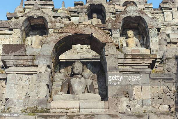 Buddha Scultures in Ancient Indonesian Borobudur UNESCO Buddhist Temple
