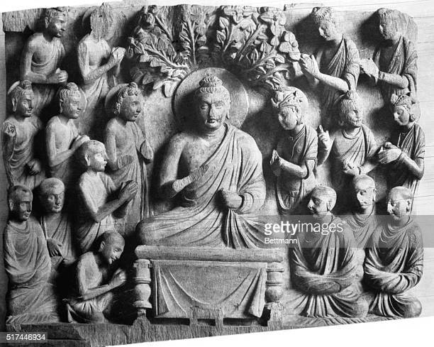 Buddha seated under the Bodhi tree worshipped by monks princes and bodhisattvas Photograph of sculpture in the Indian Museum of Sarnath 2nd Century...