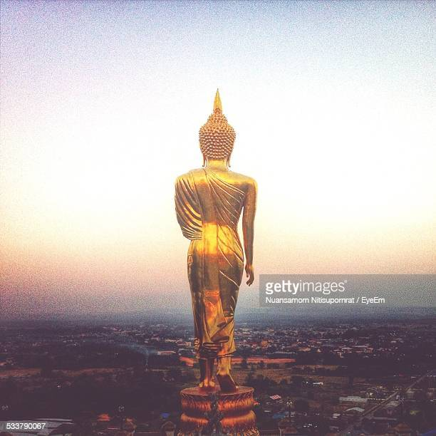 Buddha Statue Against Clear Sky At Dusk