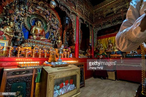 Buddha statue and butter lamps Kumbum Monastery is one of the two most important Tibetan Buddhist monasteries outside Tibet In order to commemorate...