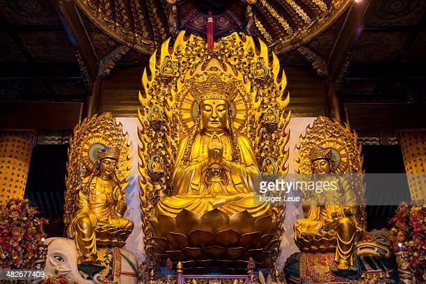 buddha statue at longhua temple - longhua temple stock photos and pictures