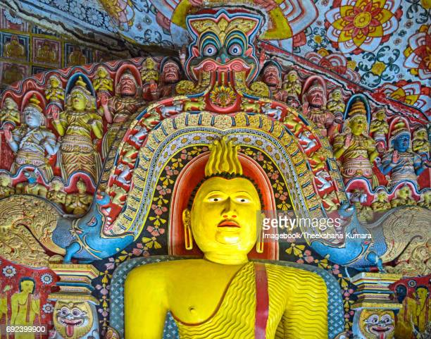 buddha statue at selawa cave temple - imagebook stock pictures, royalty-free photos & images