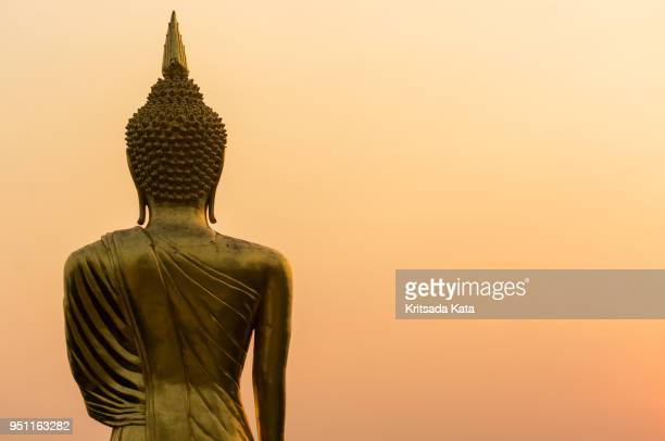 buddha statue at sunset twilight - buddha stock pictures, royalty-free photos & images