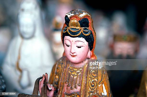 Buddha statue at the Nanputuo Temple in Xiamen. The Nanputuo Temple is located on the southeast of Xiamen Island. It is surrounded by the graceful...