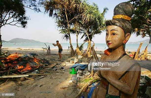 Buddha statue clasping her hands with the traditional Thai greeting stands amongst the devastation in front of the a dive shop December 27 2004 in...