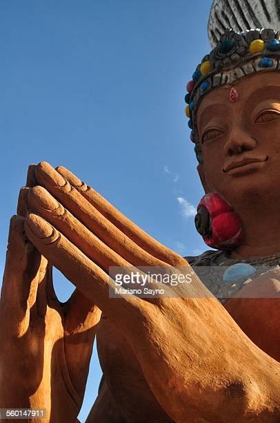 Buddha statue. Detail of hand.