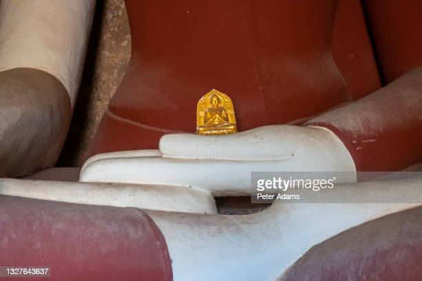buddha statue in ancient buddhist temple in bagan, myanmar - peter adams stock pictures, royalty-free photos & images