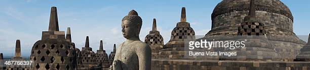 buddha statue in borobudur temple. - java stock pictures, royalty-free photos & images