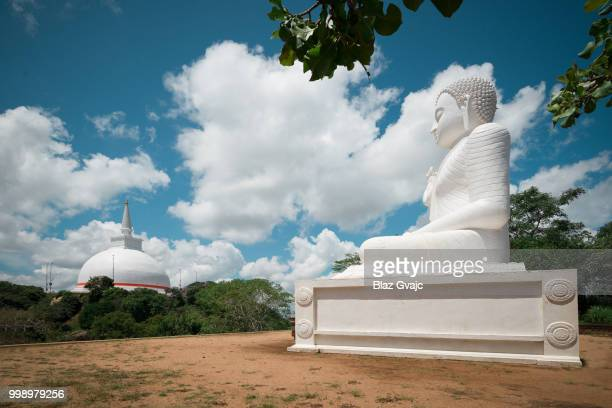 buddha statue in mihintale - mihintale stock pictures, royalty-free photos & images