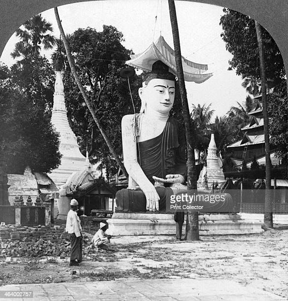 Buddha statue, Shwedagon Pagoda, Rangoon, Burma, 1908. Buddhist tradition holds that the Shwedagon Pagoda was built before the Buddha died in 486 BC,...