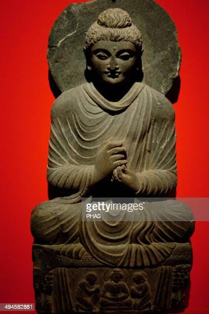 Buddha statue with dharmachakra mudra gesture Gandhara 2nd3rd centuries AD Pergamon Museum Berlin Germany