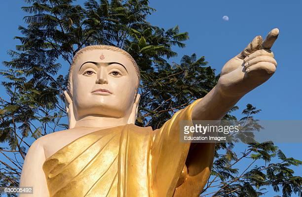 Buddha statue with extended arm and pointing finger Naung Daw Gyi Mya Tha Lyaung Bago Burma Myanmar